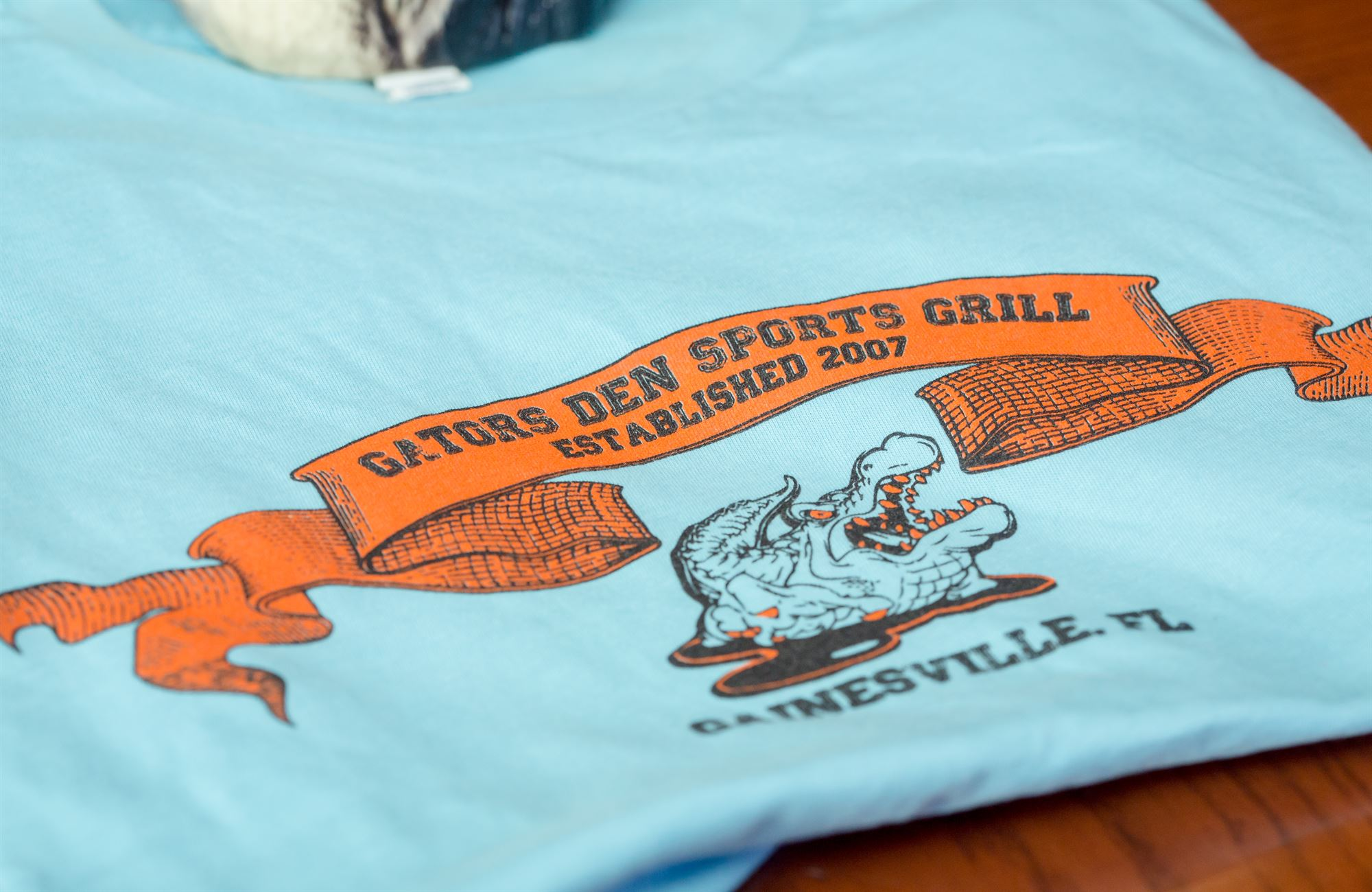 Gators Den Sports Grill shirt